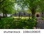 churchyard and path under... | Shutterstock . vector #1086100835