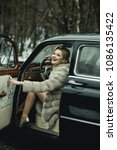Small photo of Call girl in vintage car. call girl with stylish hair and fashionable makeup