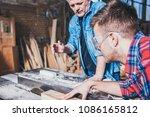 carpenters using circular saw... | Shutterstock . vector #1086165812