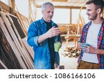 carpenters taking pause from... | Shutterstock . vector #1086166106
