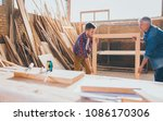 carpenters holding constructed... | Shutterstock . vector #1086170306