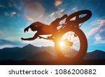 sportsman doing bike stunts in... | Shutterstock . vector #1086200882