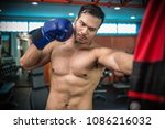handsome muscular man in boxing ... | Shutterstock . vector #1086216032