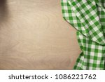 checked napkin cloth on wooden... | Shutterstock . vector #1086221762