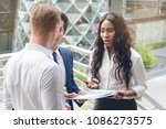 business team reviewing... | Shutterstock . vector #1086273575