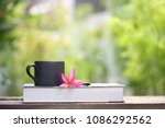 black coffee cup with flower... | Shutterstock . vector #1086292562