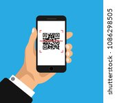 hand holds phone with qr code... | Shutterstock .eps vector #1086298505