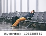 man traveling by airplane.... | Shutterstock . vector #1086305552