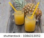 pineapple juice on a wooden... | Shutterstock . vector #1086313052