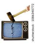 Small photo of A sledgehammer hitting an old portable television.