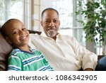 portrait of a grandfather and... | Shutterstock . vector #1086342905