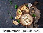 mushroom cream soup. vegan food.... | Shutterstock . vector #1086358928