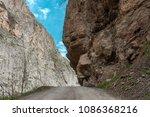 dangerous road in mountain... | Shutterstock . vector #1086368216