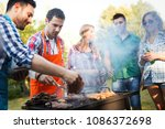 young people in nature having... | Shutterstock . vector #1086372698