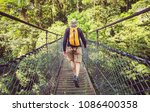 hiking in green tropical jungle ... | Shutterstock . vector #1086400358