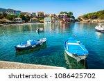 boat in the bay in assos... | Shutterstock . vector #1086425702