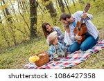 happy young couple enjoying... | Shutterstock . vector #1086427358