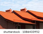 new  modern roof made of red... | Shutterstock . vector #1086433952