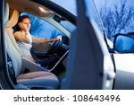 pretty young woman driving her... | Shutterstock . vector #108643496