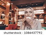 cute young muslim woman in... | Shutterstock . vector #1086437792