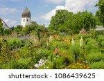 herbal garden near a monastery... | Shutterstock . vector #1086439625