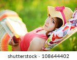 young woman lying in a hammock... | Shutterstock . vector #108644402
