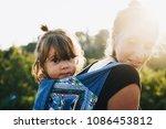 little cute girl sitting on her ... | Shutterstock . vector #1086453812