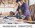 carpenter at work using  hand... | Shutterstock . vector #1086472532