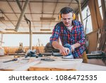 carpenter at work polishing... | Shutterstock . vector #1086472535