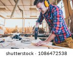 carpenter at work using  hand... | Shutterstock . vector #1086472538