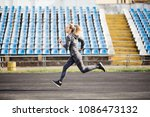 young woman running during... | Shutterstock . vector #1086473132