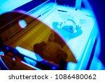 newborn baby girl receiving... | Shutterstock . vector #1086480062