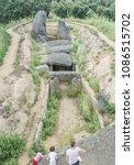 family visitors at dolmen of... | Shutterstock . vector #1086515702