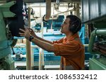 Marine Engineer Inspecting Shi...