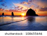 The Sunset At Cannon Beach Wit...
