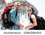 young tourist couple... | Shutterstock . vector #1086586445