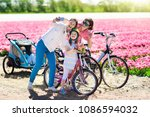 dutch family riding bicycle in... | Shutterstock . vector #1086594032