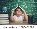 thoughtful little boy with book ... | Shutterstock . vector #1086601505