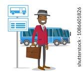 A Black Man Waiting A Bus On A...