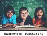 pupils  reading a book in the... | Shutterstock . vector #1086616172