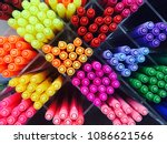 colored pens on shelves in the... | Shutterstock . vector #1086621566