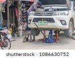 car on a jack  being repaired... | Shutterstock . vector #1086630752