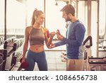 fitness instructor helping girl ... | Shutterstock . vector #1086656738