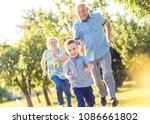grandparents with grandson... | Shutterstock . vector #1086661802