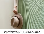 hat  beige blouse and turqoise... | Shutterstock . vector #1086666065