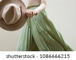hat  beige blouse and turqoise... | Shutterstock . vector #1086666215