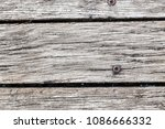 old gray wooden board in cracks.... | Shutterstock . vector #1086666332