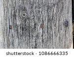 old gray wooden board in cracks....   Shutterstock . vector #1086666335