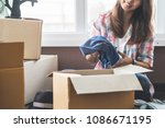 relocation moving packing stuff.... | Shutterstock . vector #1086671195