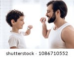 happy father and son brush... | Shutterstock . vector #1086710552